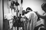 Women helping to support a mom in labor during heavy contractions.