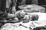 A nurse in a hospital checking the vital signs of a brand new baby.