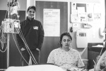 A woman sits in silence while laboring with The Seattle Birth Photographer
