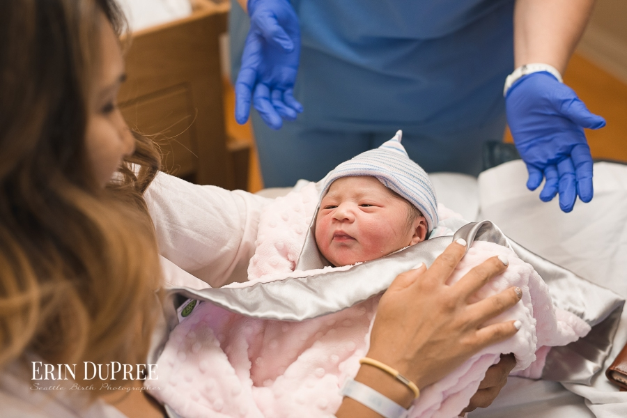 Newborn baby in pink blanket by Seattle Birth Photographer
