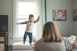 A small boy jumping off a couch, Seattle Newborn Photographer